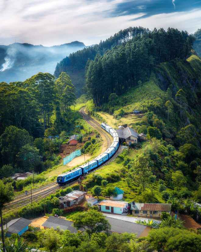 photo of railway on mountain near houses